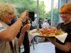 BERLIN, GERMANY - JULY 02: A guest and a waitress at the Samsung Designer Soiree at Epicentro art gallery during the Mercedes-Benz fashion week spring and summer 2014 on July 2, 2013 in Berlin, Germany. (Photo by Alexander Becher/Getty Images for Samsung)